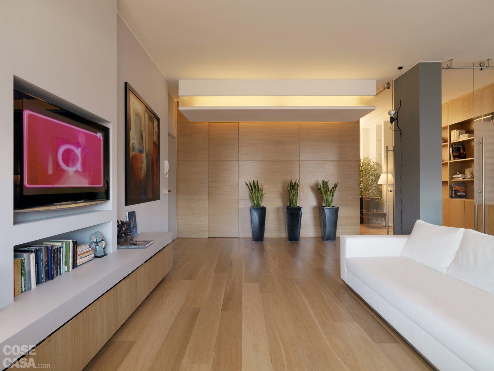 Una casa con una nuova articolata distribuzione cose di casa for Soggiorno minimalista