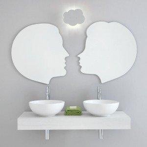 Lui & Lei di Stilhaus, una composizione a parete che comprende piano da L 120 x 50 cm con doppio lavabo d'appoggio, due specchi di L 65 x H 75 cm, un'applique. Prezzo Iva esclusa 1.700 euro. www.stilhaus.it