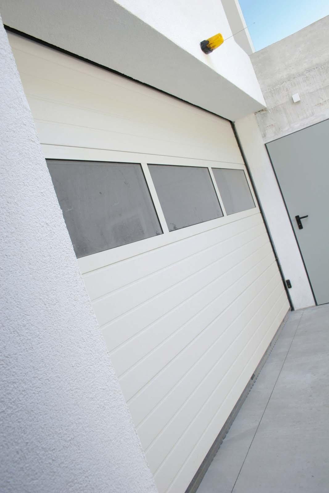 Portoni per garage cose di casa for Prezzo del garage 16x20