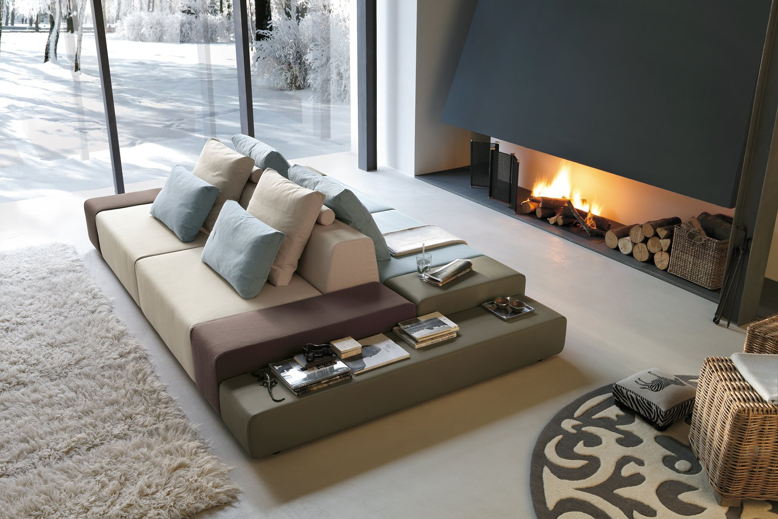 Divani con piani d 39 appoggio integrati cose di casa for Divani da design