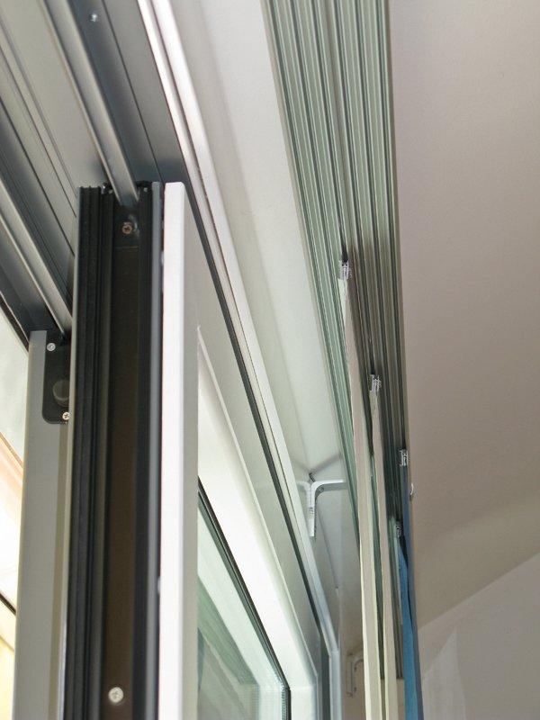 Serramento in legno e alluminio, a taglio termico, con interno laccato bianco, completo di vetrocamera: 5.000,00 euro