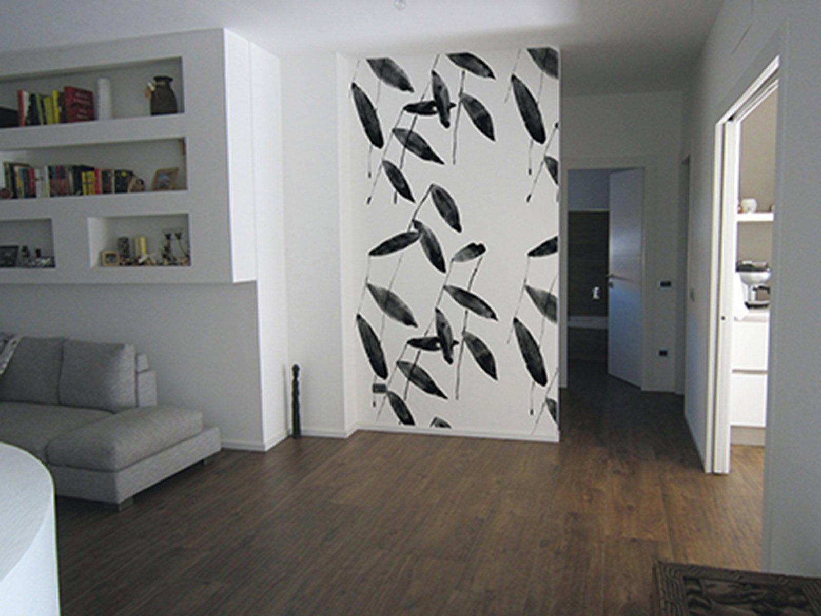 Come dipingere la parete dietro il divano design casa - Parete attrezzata con divano ...
