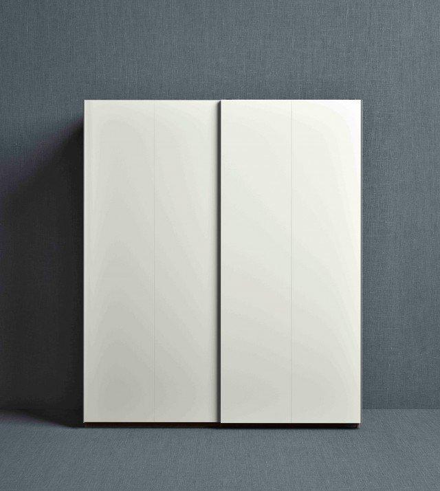 Armadio Pax Hasvik di Ikea ad ante scorrevoli in lamina a superficie verniciata effetto rovere sbiancato. Misura L 200 x P 66 x H 236 cm. Prezzo 284 cm. www.ikea.it