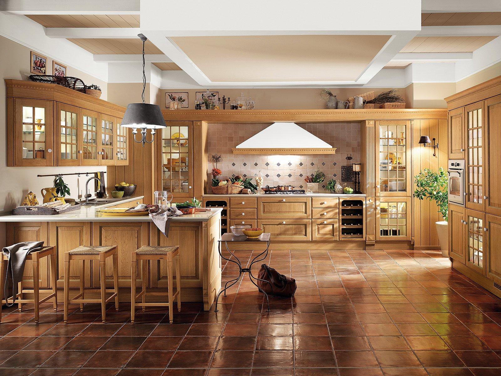 Cucina con penisola il modulo formato da un pensile e una for Case americane interni