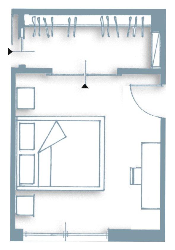 Una casa ristrutturata ridisegnando le prospettive interne - Armadio dietro al letto ...