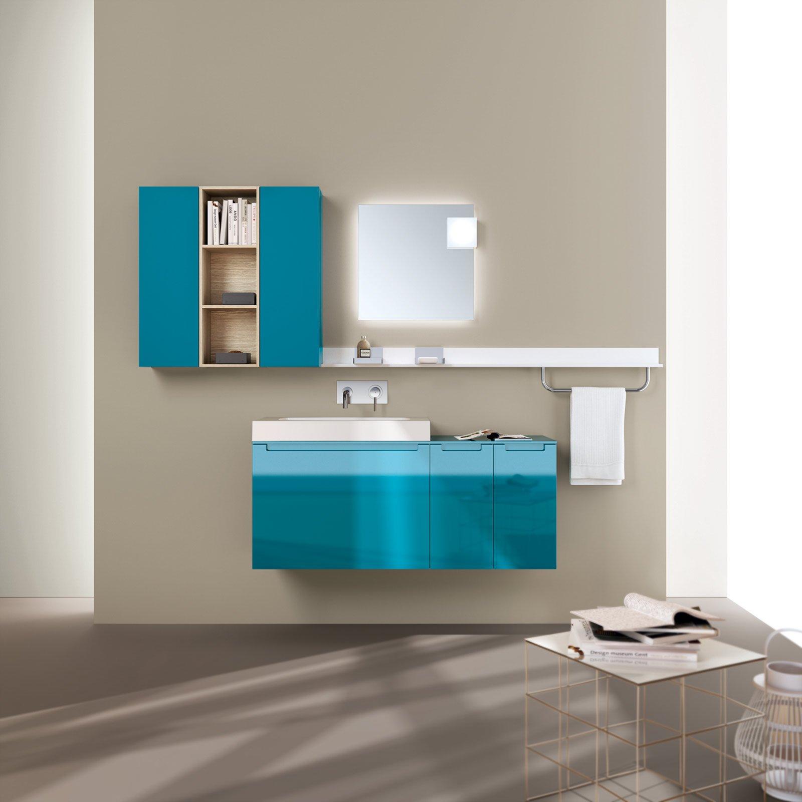 le basi e i pensili della collezione idro di scavolini bathrooms sono laccato lucido color turchese