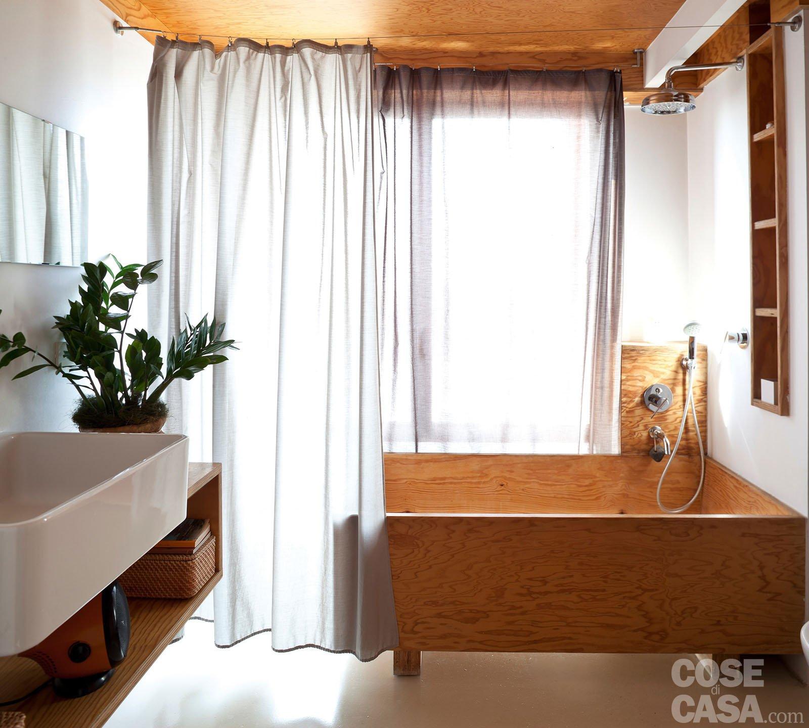 Loft una casa con materiali protagonisti e soppalco per aumentare la metratura cose di casa - Modelli di tende per bagno ...
