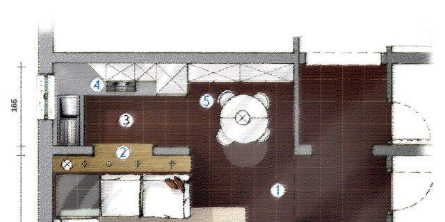 La cucina separata dal soggiorno da muretto basso con piano d'appoggio