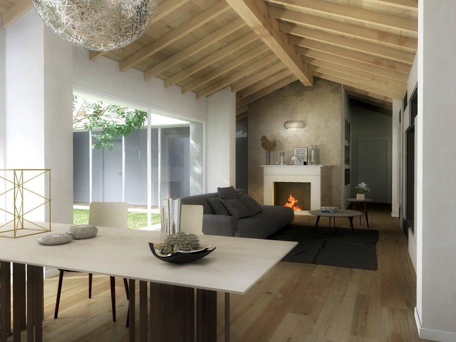 Arredamento soggiorno con camino salotto moderno con for Idee per arredare il soggiorno foto