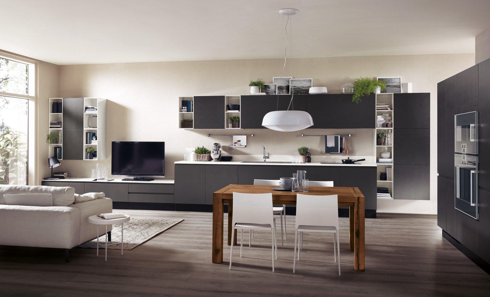 Cucine a vista per il loft nel soggiorno open space for Soggiorno living