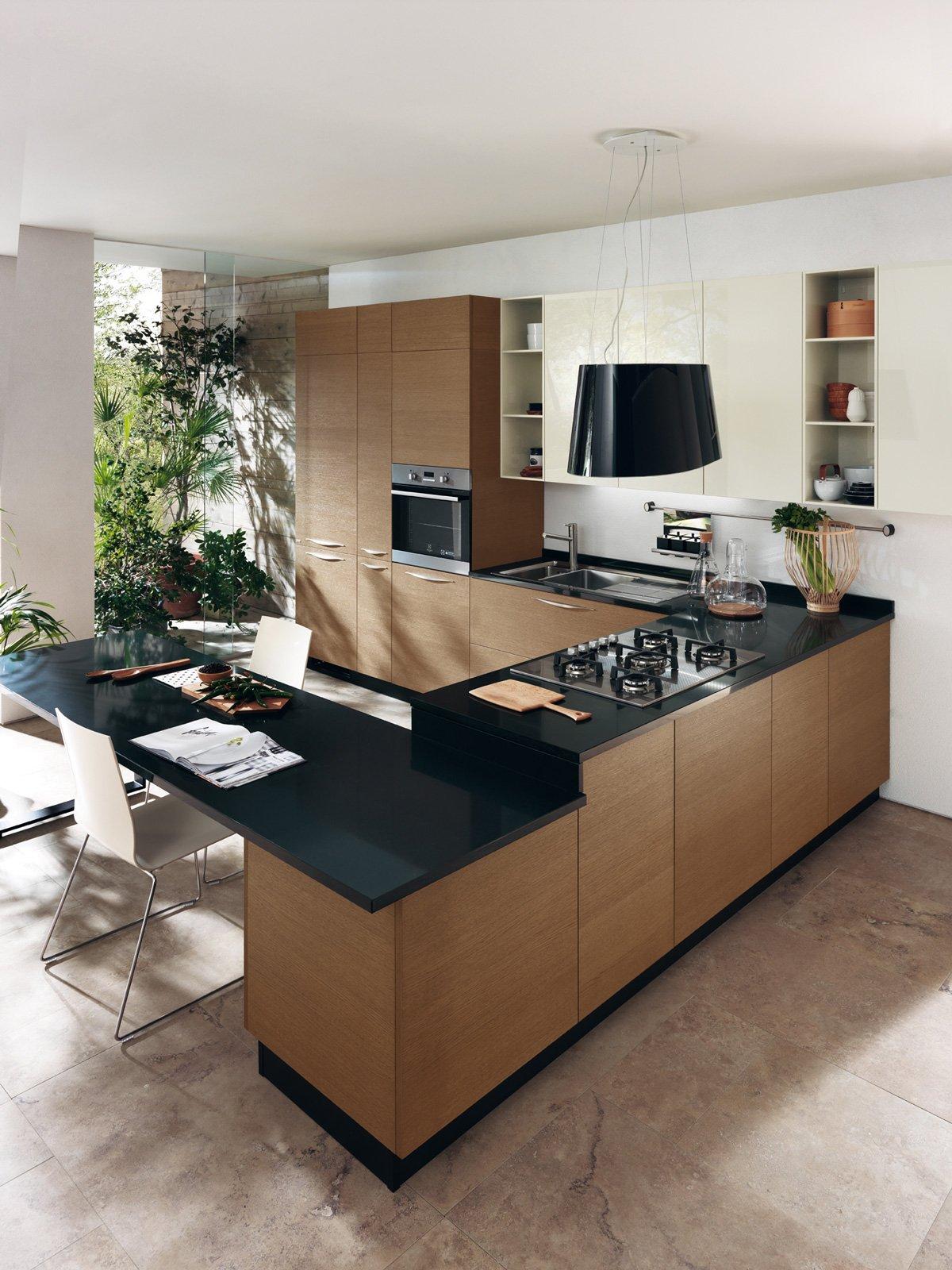Cucine con piani in contrasto cose di casa for Piani di casa artigiano california