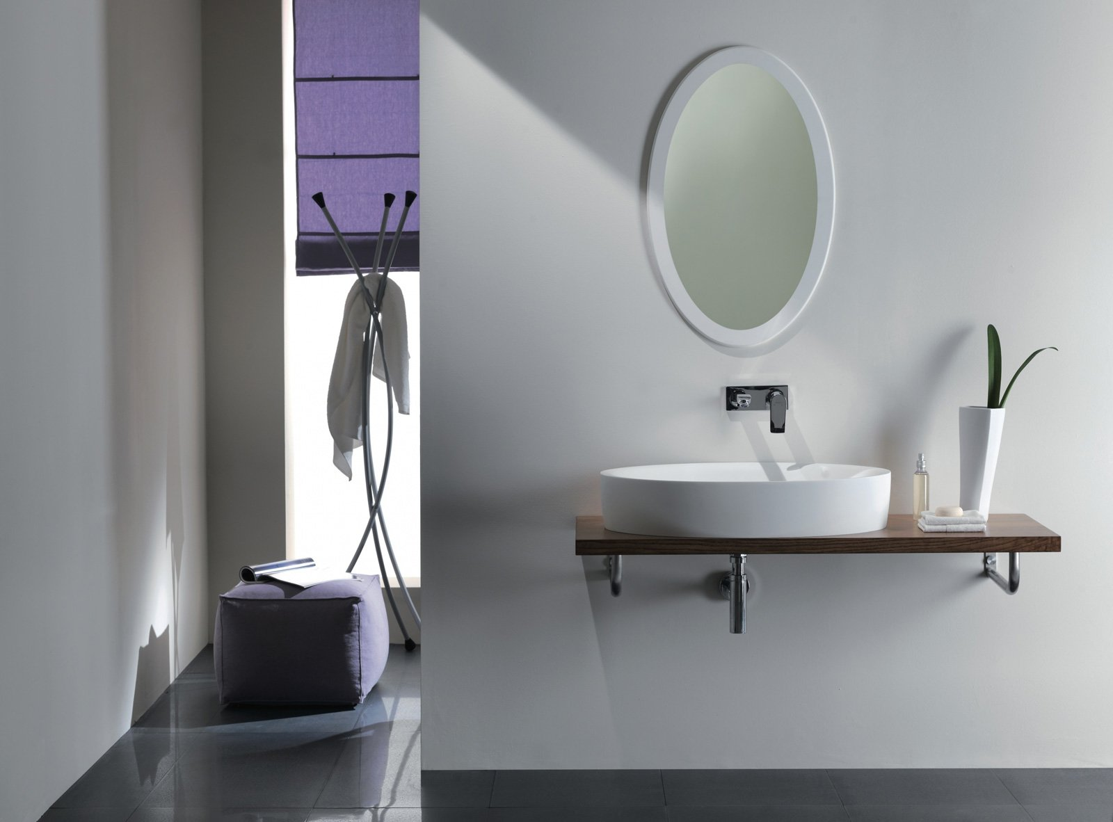 Specchi sopra il lavabo cose di casa - Specchi retroilluminati per bagno ...