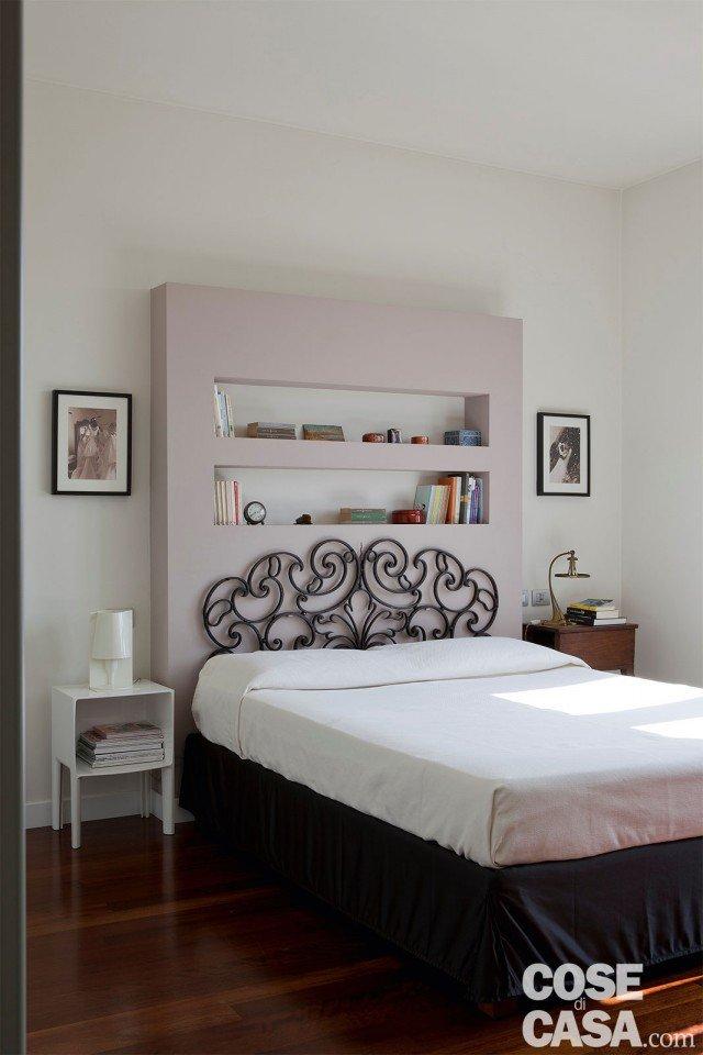 camera con controparete dietro al letto Classico più contemporaneo