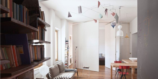 80 mq con pareti apribili che trasformano l'open space in ambienti separati