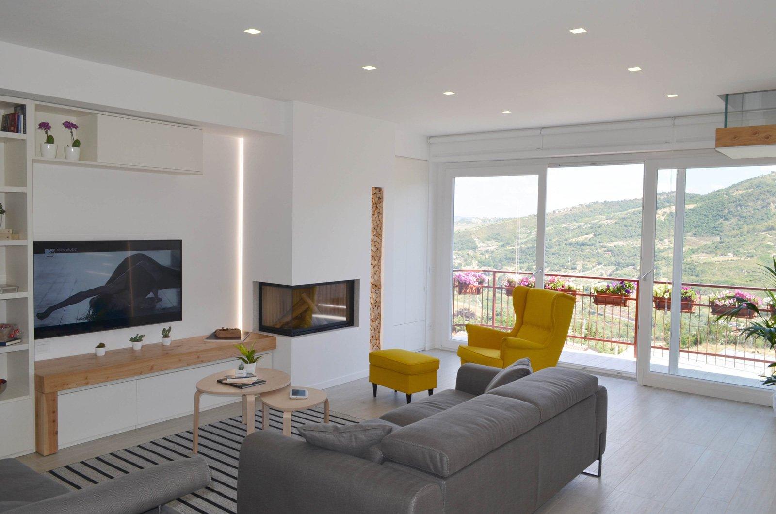Una casa con soggiorno e cucina divisi solo quando serve - Cose di Casa