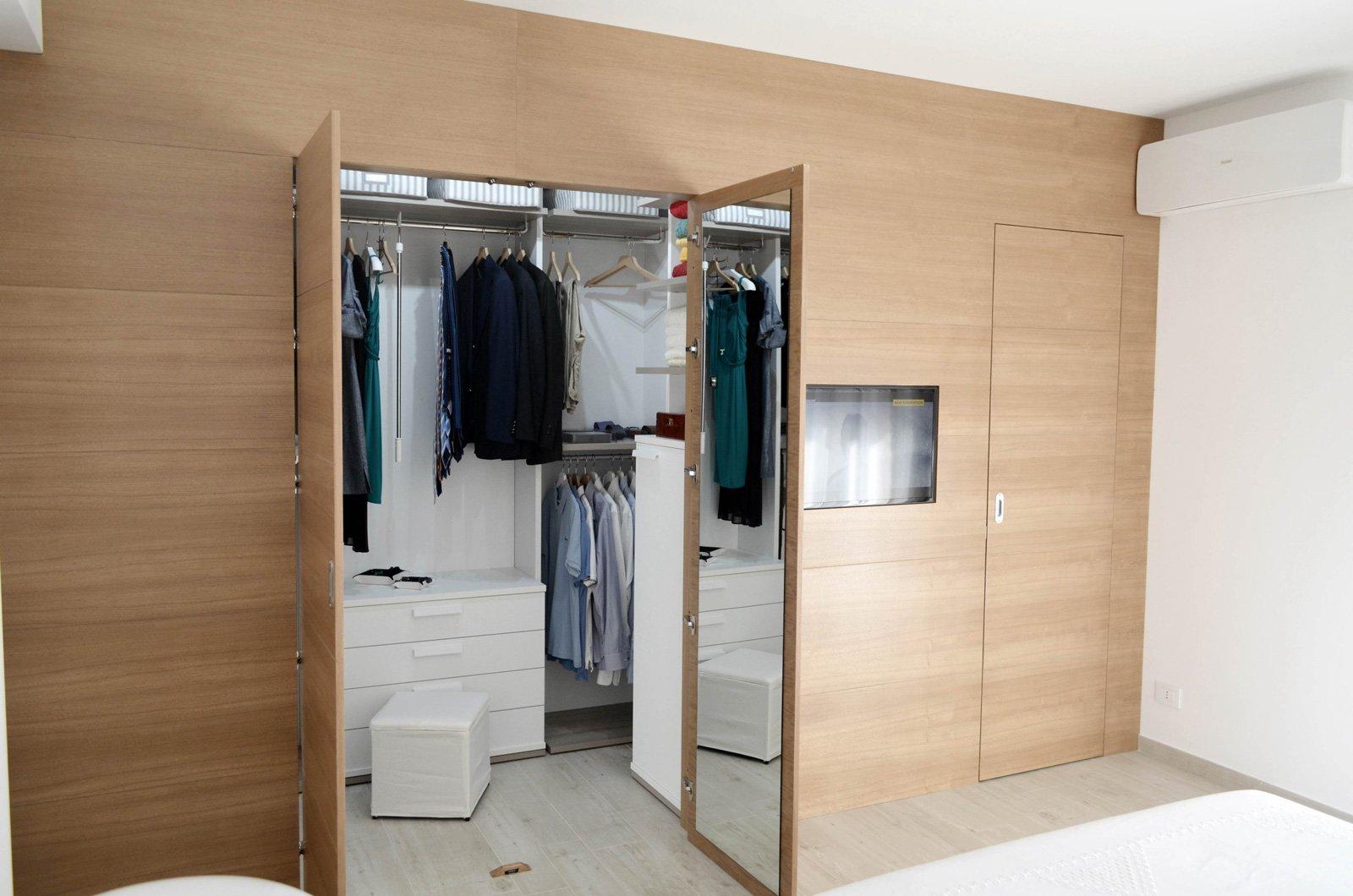 Una casa con soggiorno e cucina divisi solo quando serve for Semplici piani di casa in cabina