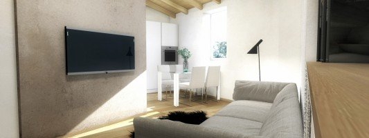 Soggiorno-cucina piccolo con parete diagonale