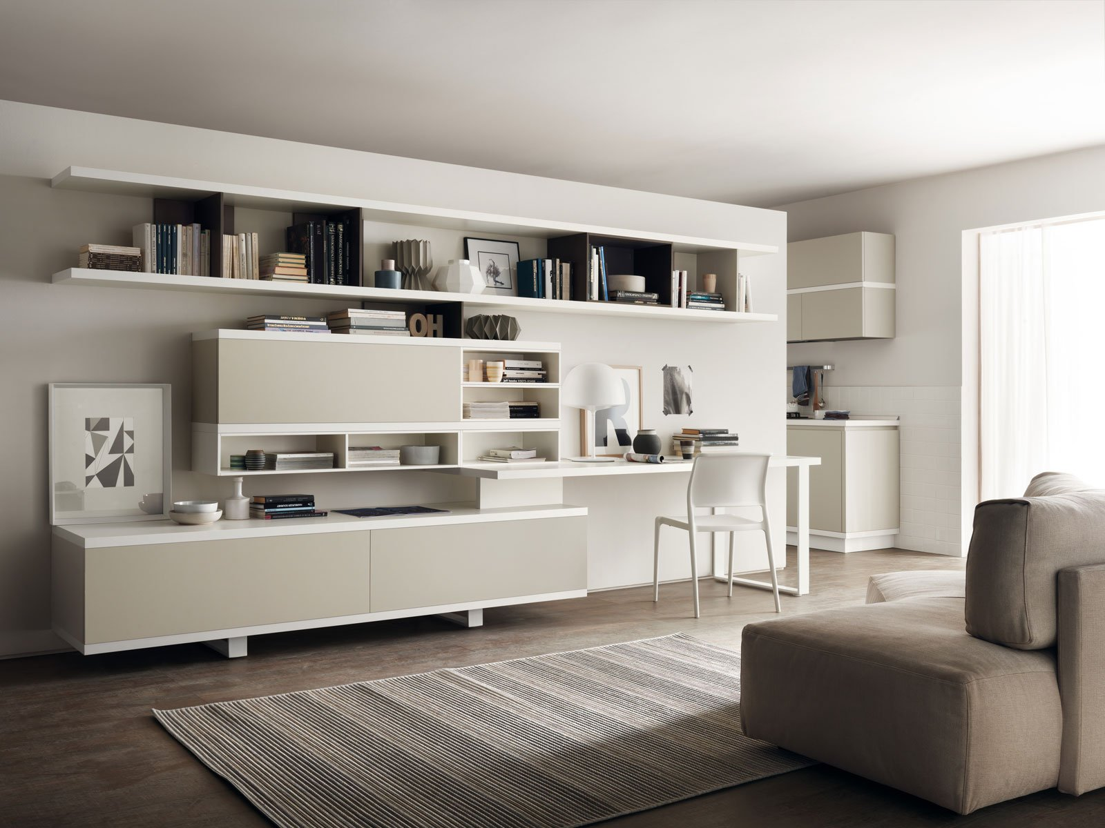 Angolo studio in soggiorno integrato nella libreria o in for Mobili salotto design