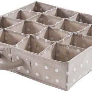Il divisorio per cassettidi Rangement & Ciein polipropilene beigea pois bianchi costa14,95 euro.www.amazon.it