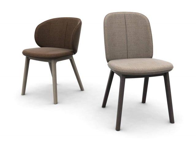 Olympia di Domitalia è la sedia disponibile in due versioni: una alta e slanciata, l'altra bassa e avvolgente. Entrambe sono imbottite e caratterizzate dalla presenza della cucitura sartoriale che attraversa verticalmente lo schienale e si trasforma in un elemento decorativo. www.domitalia.it