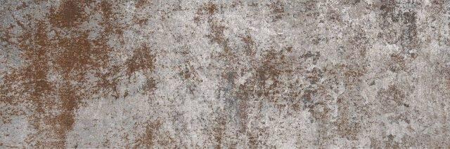S'ispira ai metalli ossidati la piastrella Cor-Ten di Ceramica Faetano in gres porcellanato a tutta massa. Misura 10 x 30 cm; al mq costa 32 euro Iva esclusa. www.delconca.com