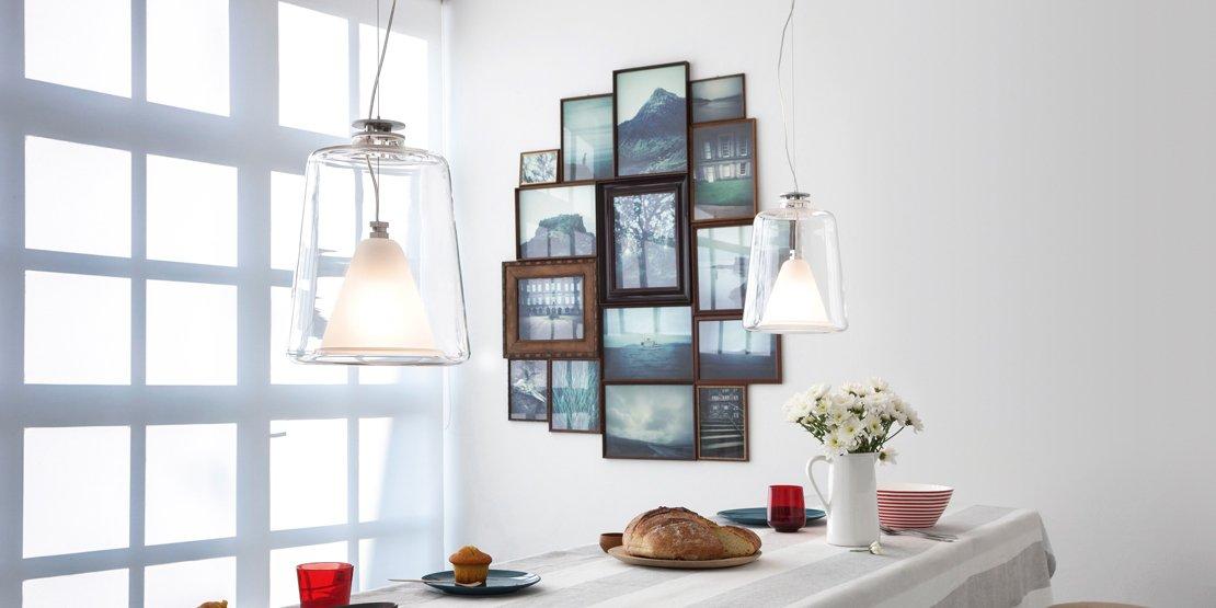 Appendere i quadri come disporli bene sulla parete for Idee per appendere foto