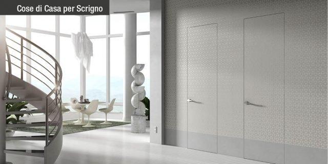 Porte filomuro Essential by Scrigno: armonia di forme, spazi e colori
