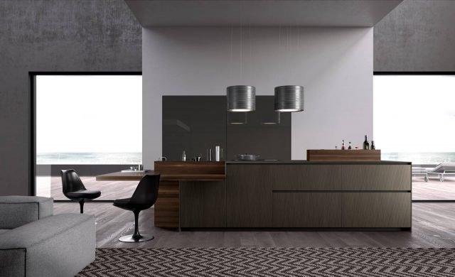 """Alumina di Comprex è la cucina con isola dal design ricercato e elegante che si apre completamente sulla zona giorno. Le ante sono realizzate in alluminio, incombustibile e riciclabile, che le rende robuste e leggere allo stesso tempo; la superficie esterna è spazzolata e risulta molto materica, come una trama tessile. Gli elementi impiallacciati in mogano fumè  """"scaldano"""" l'ambiente. Una base dell'isola da 60 cm, prezzo 581,94 euro. www.comprex.it"""