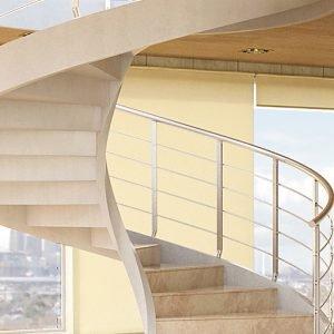 È solida e sinuosa Concrete di Rintal (www.rintal.com), con struttura in cemento armato. Può avere diametro di 124/310 cm, 12/15 gradini per giro e vari tipi di ringhiera. Prezzo su preventivo.