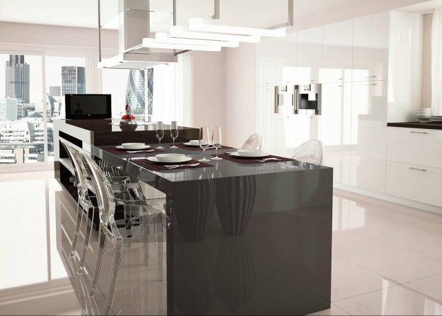 Il piano di lavoro dell'isola è realizzato in Ilexa Quartz® di Superfici Evolute, nel colore smoke gray, a base di quarzo. È disponibile in vari formati, fino a 305 x 140 cm (sp. 1,2 - 2 - 3 cm). Prezzo da rivenditore.