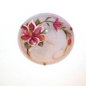 Piatto in vetro dipinto con effetto marmorizzato.
