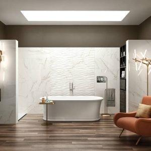 Rivestimento in bicottura effetto marmo lucido, serie JULIA, formato 35x70, disponibile nelle versioni Calacatta e Travertino con decori abbinabili, in vendita a partire da 22,99 €/Mq iva inclusa.