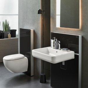Monolith di Geberit è un sottile parallelepipedo in alluminio che funge da modulo di installazione per fissare a parete lavabi, bidet e WC anche nelle versioni sospese.  Racchiude la cassetta di risciacquo con doppio pulsante laterale da 3 o 6 litri al minuto. È disponibile nella finitura bianco, nero, marrone terra d'ombra e sabbia. Misura L 48,5 x P 10,6 x H 101 cm. Prezzo 920 euro. www.geberit.it