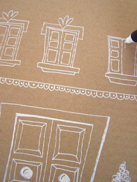 Decorate tutta la casetta con il pennarello, disegnando tegole, porta e finestre.