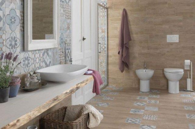 Carta da parati in bagno tra decor floreale e geometrie for Piastrelle vinile leroy merlin