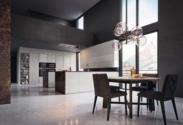 Gold Edition di Febal Casa è una cucina rifinita in modo prezioso: il top in marmo delle strutture centrali si estende fino a coprire i fianchi e riprende perfettamente il tavolo.