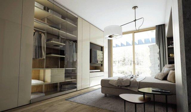 Ambientazione con armadio-mobile tv Roomy di Caccaro.