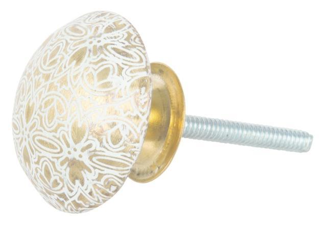 Di Maisons du Monde, il pomoloin ceramica con decori dorati misura Ø 40 mm, prezzo 4,99 euro. www.maisonsdumonde.com