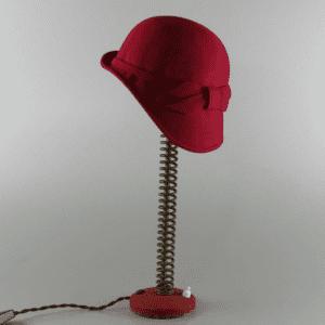 M. de Eguileor - Lady Light realizzata con cappello da signora proveniente da boutique romana, molla forcella moto, ferro verniciato