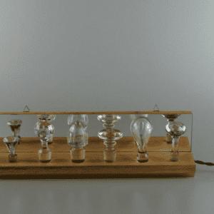 M.De Eguileor - Cafè Light realizzata con antichi tappi in cristallo, parquet rovere recuperato, specchio