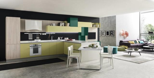 """Marina 3.0 di Febal Casa è la cucina aperta sul living che ha il piano di lavoro in Okite bianco che esalta il colore delle basi e dei pensili realizzati in Laminato Verde Limone Opaco e Verde Inglese Lucido. Le colonne sono in Nobilitato Olmo Madreperla. Il tavolo che si innesta sulla penisola permette di consumare i pasti con la famiglia. Un modulo base da 60 cm, prezzo 166 euro.  HYPERLINK """"http://Www.febalcasa.com/""""ww.febalcasa.com"""