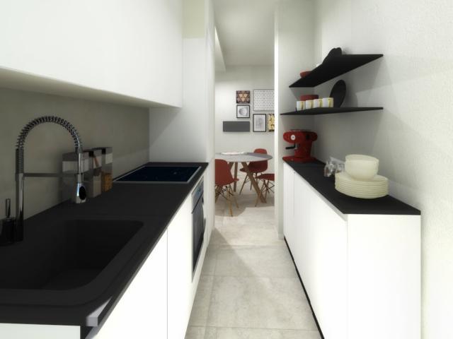 La cucina diventa angolo cottura ed è stata accorciata per far spazio alla zona pranzo pur riuscendo a contenere una comoda parete operativa e basi frontali in profondità ridotta.