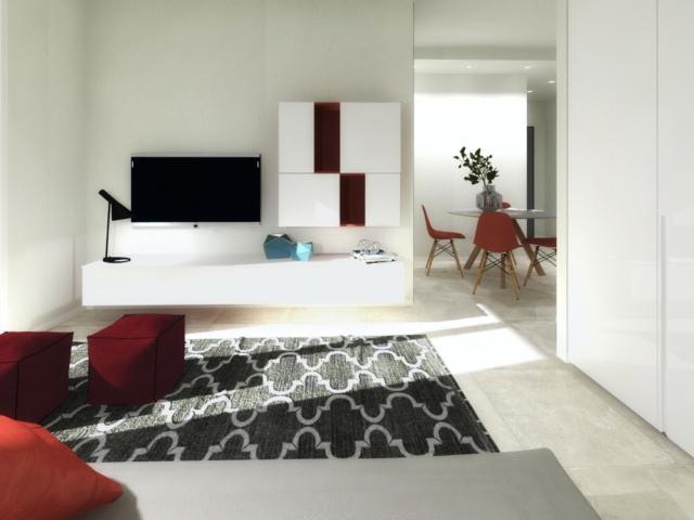 Nel nuovo soggiorno/camera la zona armadi viene mascherata sulla parete comune con il bagno.