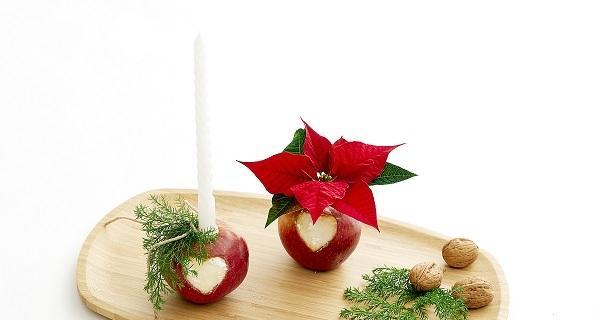Centrotavola con Stella di Natale e mele per decorare la tavola