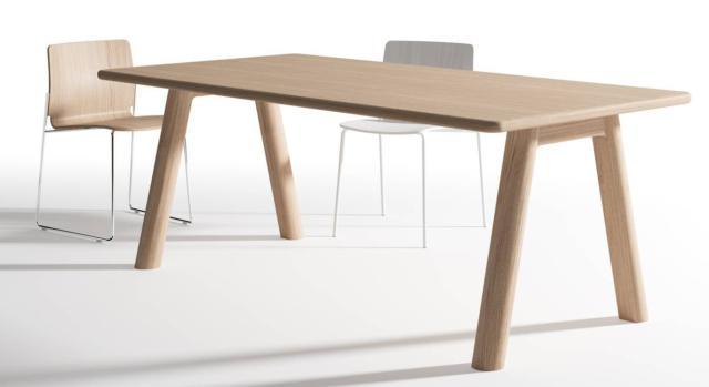 """Tran Tran di B-line, design Maddalena Casadei, è il tavolo in legno progettato per coniugare working, meeting e eating. Il top rettangolare che ha gli angoli e i bordi arrotondati poggia su due coppie di gambe cilindriche posizionate a formare una """"A"""". È disponibile in tre dimensioni nelle finiture rovere naturale o rovere verniciato nero a poro aperto. Il piano può essere realizzato anche in Mdf laccato grigio chiaro. Misura L 200/240/280 x P 100 cm. www.b-line.it"""