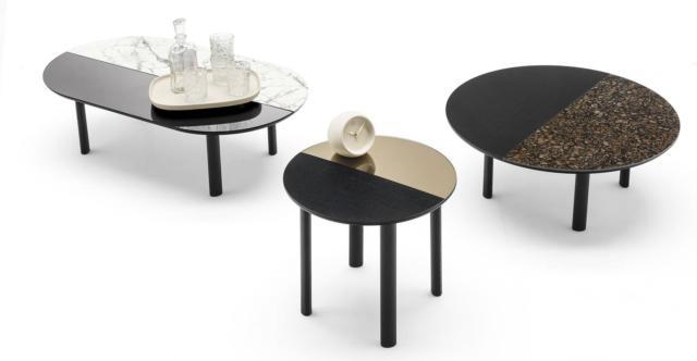 Bam di Calligaris, design Archirivolto, è il tavolino basso con le quattro gambe a sezione semi-ellittica in legno di frassino laccato nero opaco. Il top rotondo o ellittico, formato da due sezioni, è disponibile in diverse finiture: legno laccato nero e specchio o ceramica oppure specchio e ceramica. Misura ø  50 x H 45 cm, ø 70 x H 35 cm e L 120 x P 60 x H 35 cm. www.calligaris.it