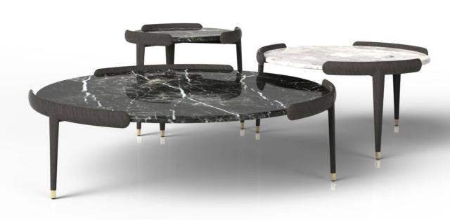 Amos di Opera Contemporary è il tavolino con la struttura in legno massello a sezione ovale composta da tre gambe affusolate con puntali in ottone; il piano è in pregiato marmo disponibile in diverse varianti. www.operacontemporary.com