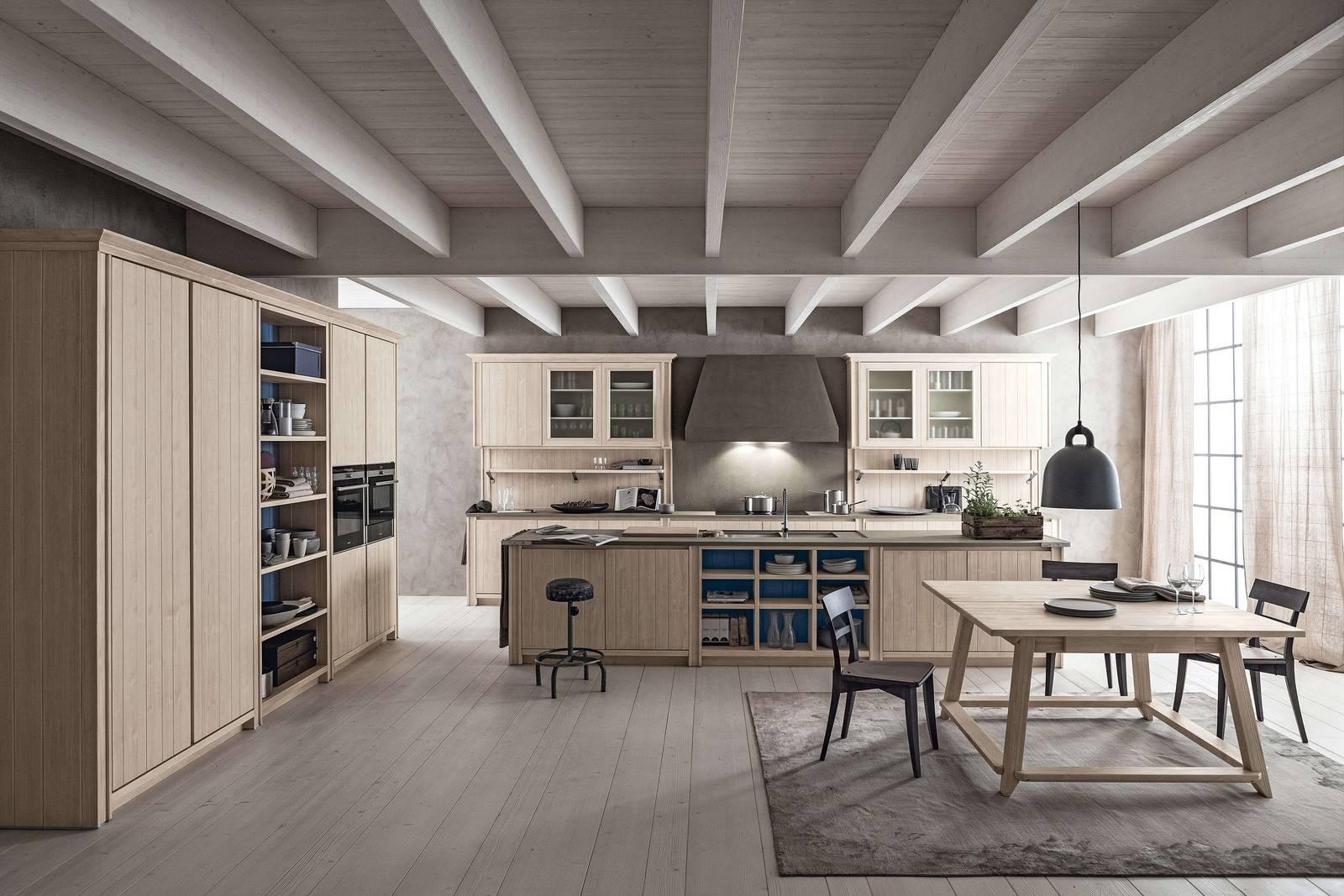 Cucina con isola nel soggiorno open space cose di casa for Foto interni case classiche
