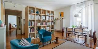 Open space di 65 mq con libreria che separa