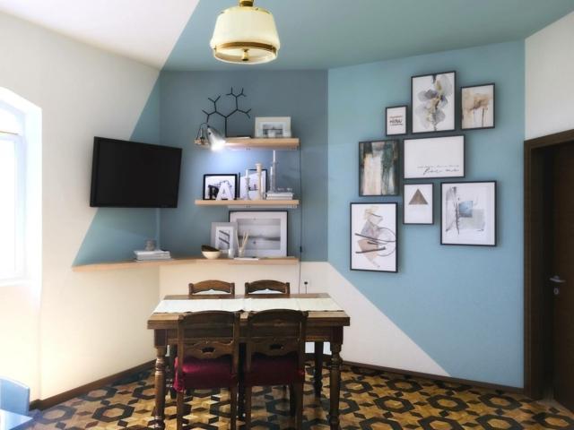 zona pranzo con pareti oblique da arredare